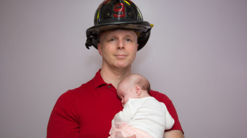 79ff08464 Newborn Baby Girl in Dad s Firefighter Gear by Ronnie Saini Photography